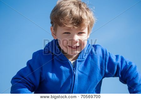 Young Boy against a Blue Sky