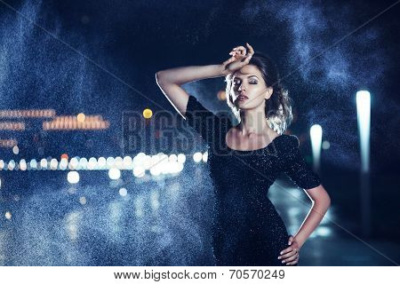 Woman posing in the rain.