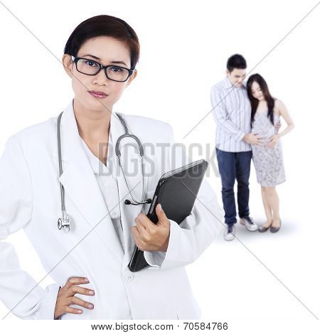 Family Visiting An Obstetrician