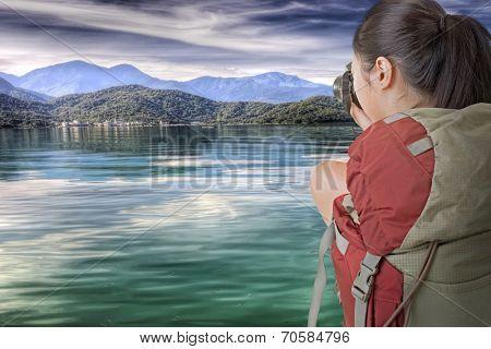 Asian female backpacker take photo at Sun Moon Lake, Taiwan, Asia.