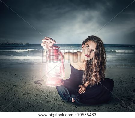 young woman illuminating the night with a lantern
