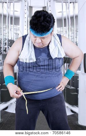 Obese Man Measuring His Belly 1