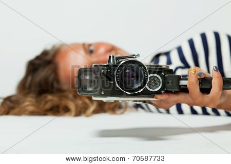 girl with an 8mm retro movie camera