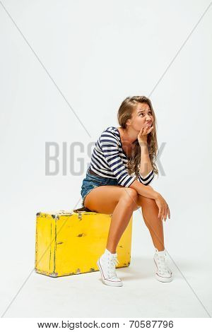 girl sitting on a suitcase
