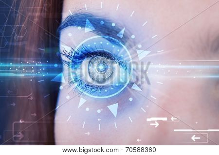Modern cyber girl with technolgy eye looking into blue iris