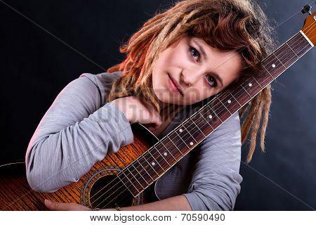 Girl With Dreadlocks Holding Guitar