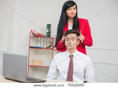 Woman doing massage to her colleague in office