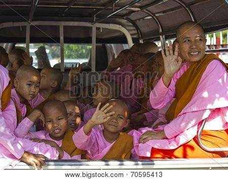 Little Girl Monks in A Van
