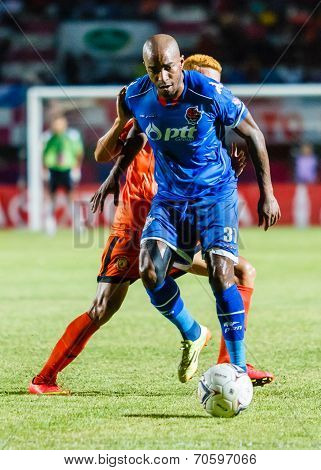 Sisaket Thailand-august 13: Yves Desmarets Of Ptt Rayong Fc. (blue) In Action During Thai Premier Le