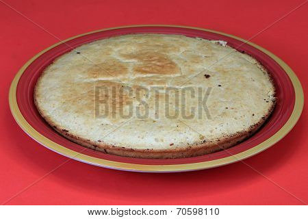 Corn Pone On Red Plate