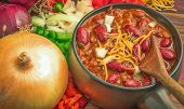 foto of shredded cheese  - Bowl of chili topped with shredded cheese - JPG