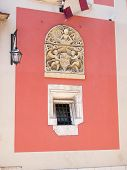 stock photo of building relief  - The old window and relief from historical building in Krakow - JPG