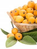 stock photo of loquat  - basket full of loquat fruits close up - JPG