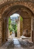 pic of underpass  - picturesque narrow alley with archway in the ancient town Gualdo Cattaneo - JPG