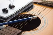 pic of risque  - Notebook and pencil on guitar - JPG