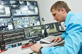 image of cctv  - security guard watching video monitoring surveillance security system - JPG