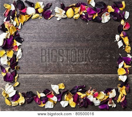 Frame With Dry Rose Petals On Wooden Background