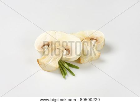 two slices of champignon mushroom with herbs