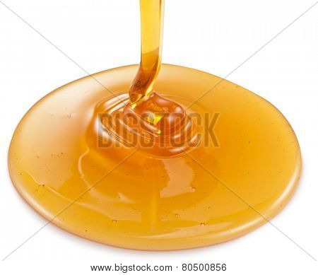Honey flowing on white background. Clipping paths.