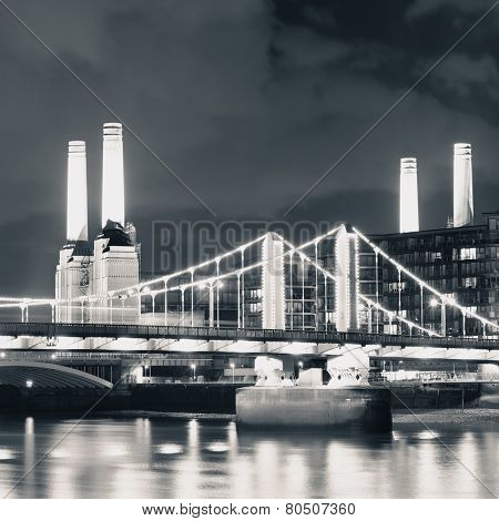 Battersea Power Station over Thames river as the famous London landmark at night.