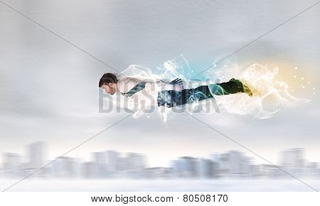 Hero super flying above city with smoke left behind concept