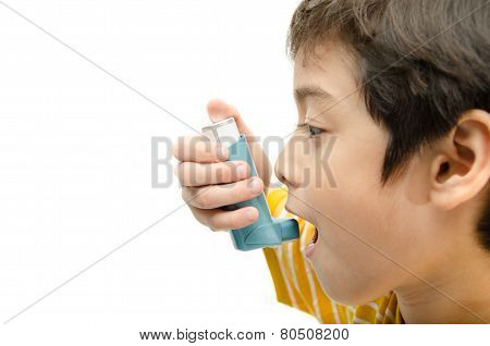 Little Boy Using Asthma Inhaler For Breathing On White Background
