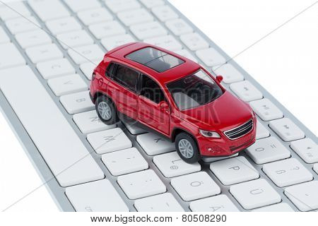car on keyboard symbol photo for car buying and car trade on the internet