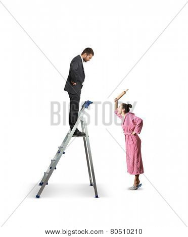 angry woman with rolling pin screaming at serious man on the stepladder. isolated on white background