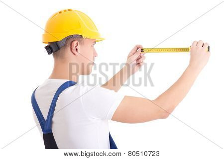 Back View Of Man Builder In Blue Coveralls Holding Measure Tape Isolated On White