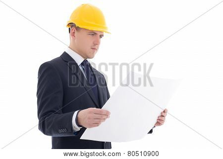 Portrait Of Handsome Business Man In Yellow Builder's Helmet With Blueprint Isolated On White
