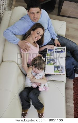 Happy Family Looking Photos At Home