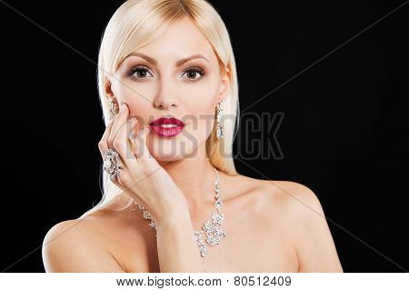 portrait of a beautiful blonde woman with luxury accessories. fashion model