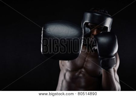 Young Muscular Man Practicing Boxing
