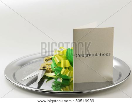 green yellow ribbon bows, scissors and a greeting card