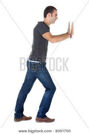 Man Pushing A Wall