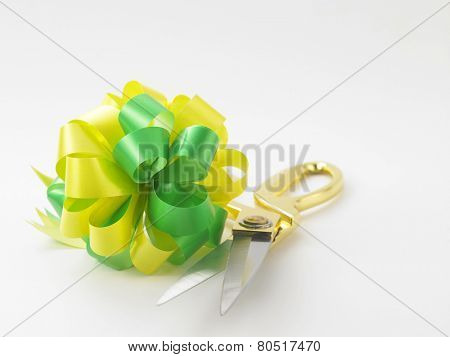 green yellow ribbon bows and scissors