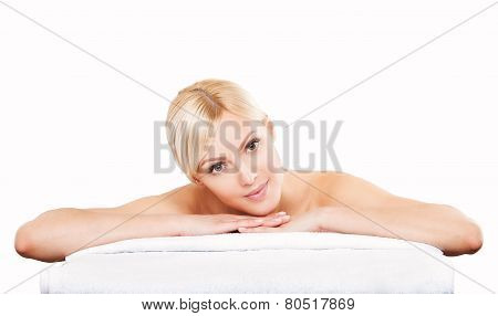 Beautiful young woman relaxing after massage. Spa salon.