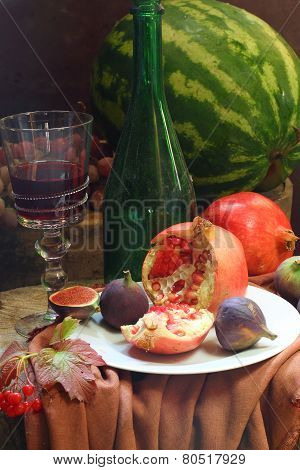 Red Wine With A Pomegranate And A Fig