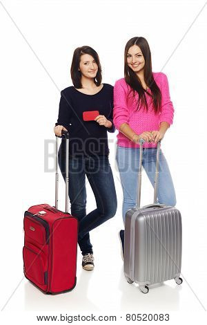 Two friends girls with travel suitcases