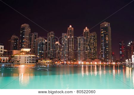 DUBAI - OCTOBER 13: area near the Dubai Fountain on October 13, 2014 in Dubai, UAE. The Dubai Fountain is the world's largest choreographed fountain system set on the 30-acre manmade Burj Khalifa Lake