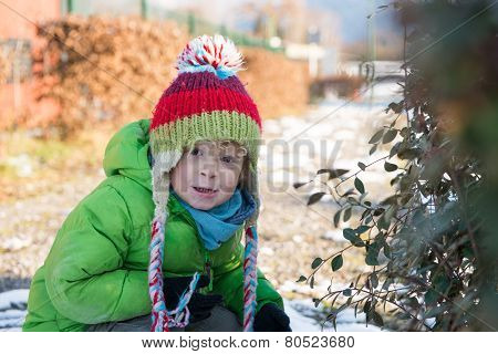 A Child With His  Winter Cap