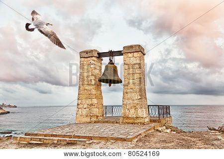 Seagull flies over bell of Chersonesos in Chersonesos Taurica