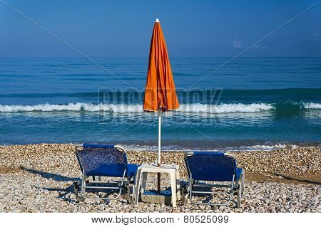 parasol and beds on the beach