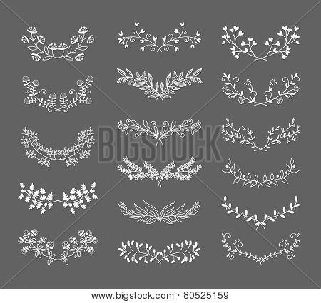 Symmetrical floral graphic design elements