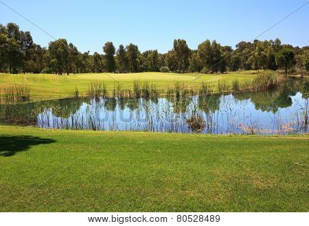 Golf course with water hazard.
