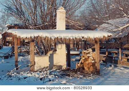 Stove Under A Canopy In Winter