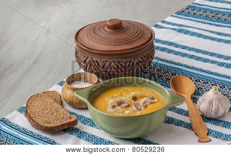 Pumpkin Soup With Fried Onions And Meat With Bacon