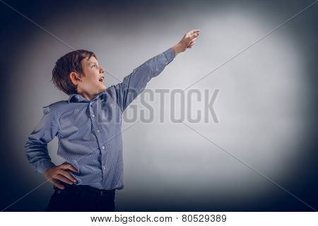 adolescent boy brown experiences happiness showing thumb up on a