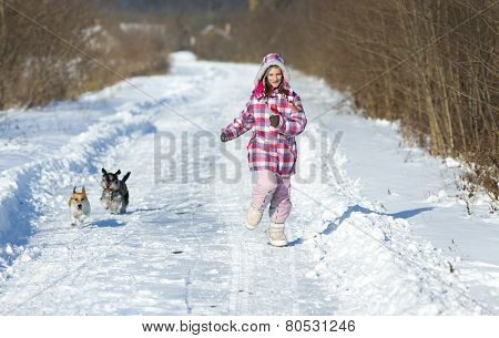 Girl With Dogs On Snow