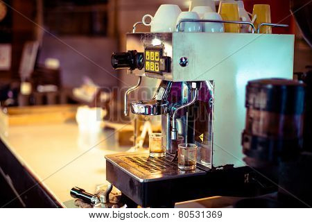 Close Up Of Professional Coffee Machine Making Espresso In A Cafe
